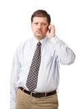 Homem de negócios que fala em seu telefone móvel Fotos de Stock Royalty Free