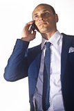 Homem de negócios que fala no telefone Fotografia de Stock Royalty Free