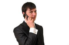 HOMEM DE NEGÓCIOS QUE FALA NO TELEFONE MÓVEL Fotografia de Stock