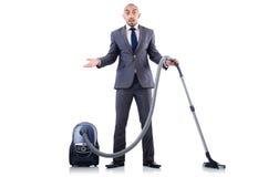 Homem de negócios que faz a limpeza do vácuo Fotografia de Stock Royalty Free