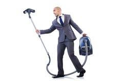Homem de negócios que faz a limpeza do vácuo Fotos de Stock
