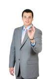 Homem de negócios que faz o sinal aprovado Imagens de Stock