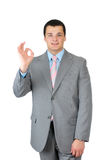 Homem de negócios que faz o sinal aprovado Imagem de Stock