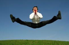 Homem de negócios que faz splits Imagem de Stock