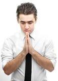 Homem de negócios que faz uma oração Fotografia de Stock Royalty Free