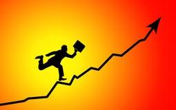 Homem de negócios que funciona para representar graficamente o pico Fotografia de Stock Royalty Free