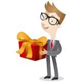 Homem de negócios que guarda a caixa de presente Fotos de Stock Royalty Free