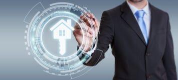 Homem de negócios que guarda a casa do ícone da rendição 3D em sua mão Imagens de Stock Royalty Free
