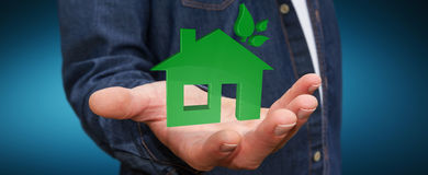 Homem de negócios que guarda a casa e o uso eficaz da energia do eco 3D Fotografia de Stock
