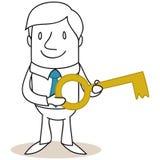 Homem de negócios que guarda a chave dourada Imagens de Stock