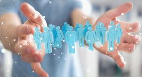 Homem de negócios que guarda 3D que rende o grupo de pessoas em sua mão Imagem de Stock Royalty Free
