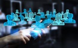 Homem de negócios que guarda 3D que rende o grupo de povos azuis Foto de Stock Royalty Free