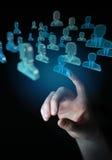 Homem de negócios que guarda 3D que rende o grupo de povos azuis Imagem de Stock Royalty Free