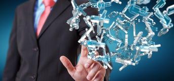 Homem de negócios que guarda 3D que rende o grupo de povos azuis Fotografia de Stock Royalty Free