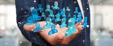 Homem de negócios que guarda 3D que rende o grupo de povos azuis Fotografia de Stock