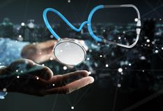 Homem de negócios que guarda e que toca no renderi de flutuação do estetoscópio 3D Foto de Stock Royalty Free