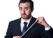 Homem de negócios que guarda a fita de medição Fotografia de Stock