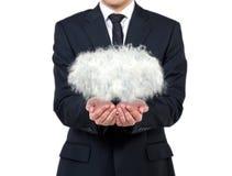 Homem de negócios que guarda a nuvem Imagens de Stock