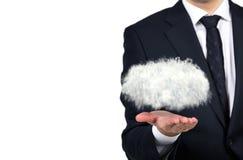Homem de negócios que guarda a nuvem Imagem de Stock