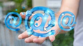 Homem de negócios que guarda o ícone do email da rendição 3D em sua mão Imagem de Stock