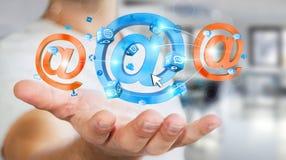 Homem de negócios que guarda o ícone do email da rendição 3D em sua mão Imagens de Stock