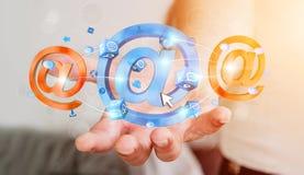 Homem de negócios que guarda o ícone do email da rendição 3D em sua mão Foto de Stock