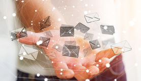 Homem de negócios que guarda o ícone do email do voo da rendição 3D em sua mão Fotografia de Stock Royalty Free