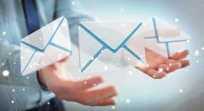 Homem de negócios que guarda o ícone do email do voo da rendição 3D em sua mão Imagem de Stock Royalty Free