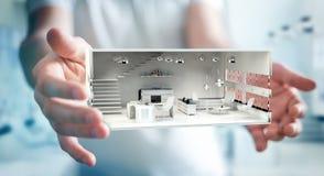 Homem de negócios que guarda o apartamento branco da rendição 3D Imagens de Stock Royalty Free
