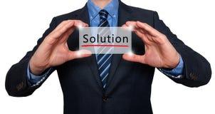 Homem de negócios que guarda o cartão branco com sinal da solução, branco - estoque Imagens de Stock