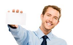 Homem de negócios que guarda o cartaz branco vazio que mostra o espaço da cópia fotos de stock