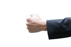 homem de negócios que guarda o punho e que aumenta no ar Foto de Stock