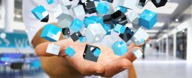 Homem de negócios que guarda o renderin brilhante azul de flutuação da rede 3D do cubo Imagem de Stock Royalty Free