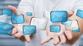Homem de negócios que guarda o rendering' digital dos ícones '3D do email Imagem de Stock Royalty Free