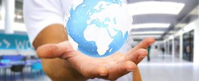 Homem de negócios que guarda o rendering' tátil digital do mundo '3D Foto de Stock Royalty Free