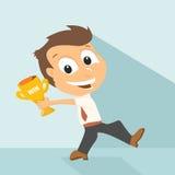 Homem de negócios que guarda o troféu de vencimento Imagem de Stock Royalty Free