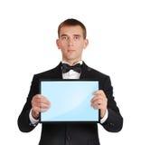 Homem de negócios que guarda a tabuleta Fotografia de Stock Royalty Free