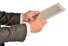 Homem de negócios que guarda a tabuleta digital, close up Foto de Stock