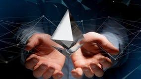 Homem de negócios que guarda um aroun cripto do voo do sinal de moeda de Ethereum Foto de Stock Royalty Free
