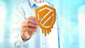 Homem de negócios que guarda um ataque do processador da fusão com engodo da rede Foto de Stock Royalty Free