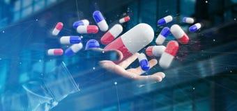 Homem de negócios que guarda um 3d que rende o grupo de comprimidos médicos Fotos de Stock Royalty Free
