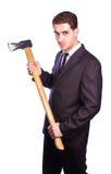 Homem de negócios que guarda um machado Fotografia de Stock
