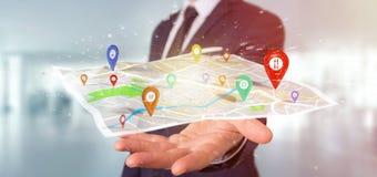 Homem de negócios que guarda um suporte do pino da rendição 3d em um mapa Fotos de Stock