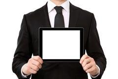 Homem de negócios que guarda um tablet pc com tela isolada fotografia de stock royalty free
