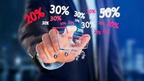 Homem de negócios que guarda um trole e um disconto vermelhos e brancos das vendas - Imagens de Stock