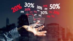 Homem de negócios que guarda um trole e um disconto vermelhos e brancos das vendas - Foto de Stock