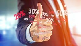 Homem de negócios que guarda um trole e um disconto vermelhos e brancos das vendas - Foto de Stock Royalty Free