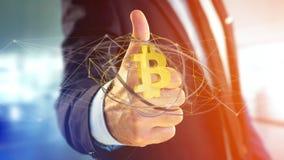 Homem de negócios que guarda um voo cripto do sinal de moeda de Bitcoin ao redor Fotografia de Stock Royalty Free