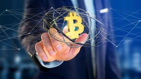 Homem de negócios que guarda um voo cripto do sinal de moeda de Bitcoin ao redor Imagem de Stock