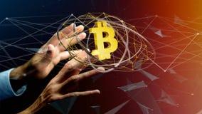 Homem de negócios que guarda um voo cripto do sinal de moeda de Bitcoin ao redor Imagens de Stock